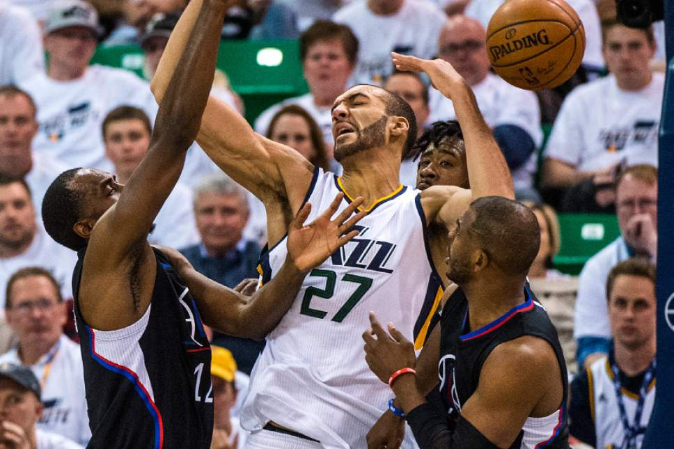Chris Detrick  |  The Salt Lake Tribune LA Clippers forward Luc Mbah a Moute (12) Utah Jazz center Rudy Gobert (27) LA Clippers center DeAndre Jordan (6) and LA Clippers guard Chris Paul (3) go for the ball during the game at Vivint Smart Home Arena Friday, April 28, 2017.