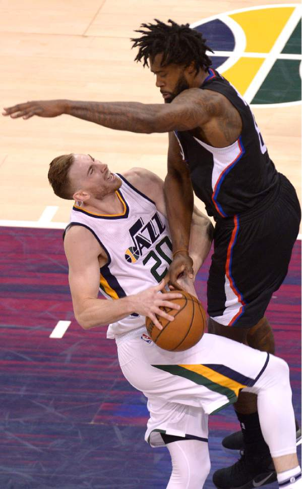 Leah Hogsten  |  The Salt Lake Tribune  Utah Jazz forward Gordon Hayward (20) is fouled by LA Clippers center DeAndre Jordan (6). The Utah Jazz fall to the Los Angeles Clippers 93-98 during Game 6 at Vivint Smart Home Arena, Friday, April 28, 2017 during the NBA's first-round playoff series.