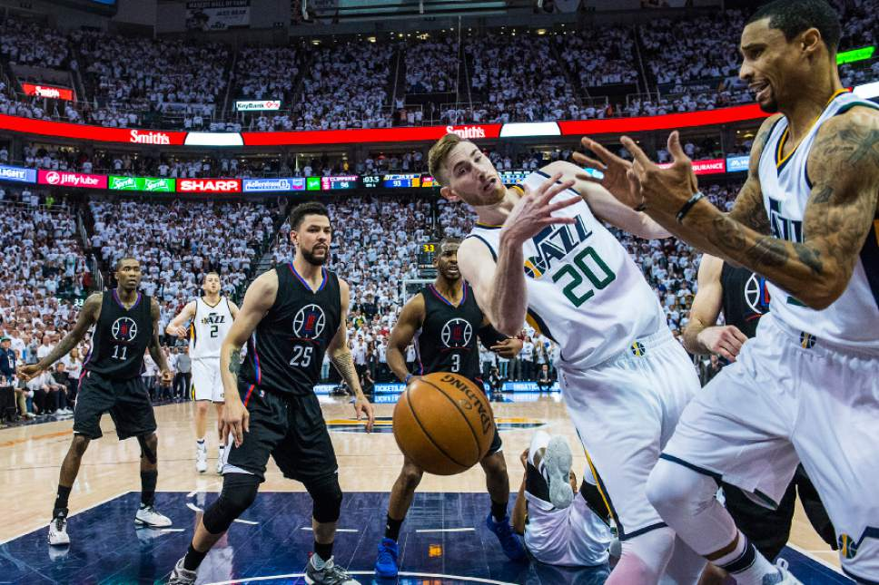 Chris Detrick  |  The Salt Lake Tribune Utah Jazz forward Gordon Hayward (20) Utah Jazz guard George Hill (3) LA Clippers guard JJ Redick (4) and LA Clippers guard Austin Rivers (25) go for a rebound during the game at Vivint Smart Home Arena Friday, April 28, 2017.  LA Clippers defeated Utah Jazz 98-93.