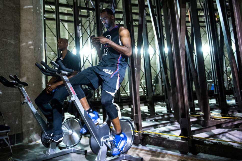 Chris Detrick  |  The Salt Lake Tribune LA Clippers forward Luc Mbah a Moute (12) checks his phone while riding a stationary bike after the game at Vivint Smart Home Arena Friday, April 28, 2017.  LA Clippers defeated Utah Jazz 98-93.