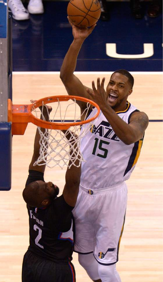 Leah Hogsten  |  The Salt Lake Tribune  Utah Jazz forward Derrick Favors (15) hits the net over LA Clippers guard Raymond Felton (2). The Utah Jazz trail the Los Angeles Clippers 59-62 in the third quarter during Game 6 at Vivint Smart Home Arena, Friday, April 28, 2017 during the NBA's first-round playoff series.