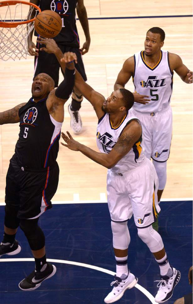 Leah Hogsten  |  The Salt Lake Tribune  Utah Jazz forward Derrick Favors (15) battles LA Clippers center Marreese Speights (5) in the paint. The Utah Jazz trail the Los Angeles Clippers 59-62 in the third quarter during Game 6 at Vivint Smart Home Arena, Friday, April 28, 2017 during the NBA's first-round playoff series.
