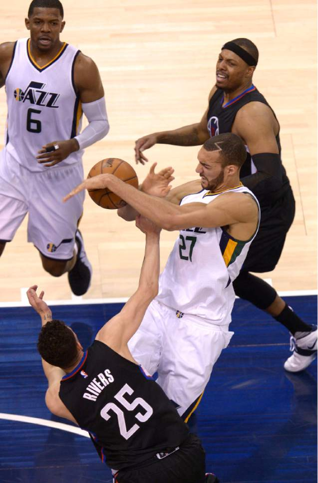 Leah Hogsten  |  The Salt Lake Tribune  Utah Jazz center Rudy Gobert (27) battles LA Clippers guard Austin Rivers (25) in the paint. The Utah Jazz trail the Los Angeles Clippers 59-62 in the third quarter during Game 6 at Vivint Smart Home Arena, Friday, April 28, 2017 during the NBA's first-round playoff series.
