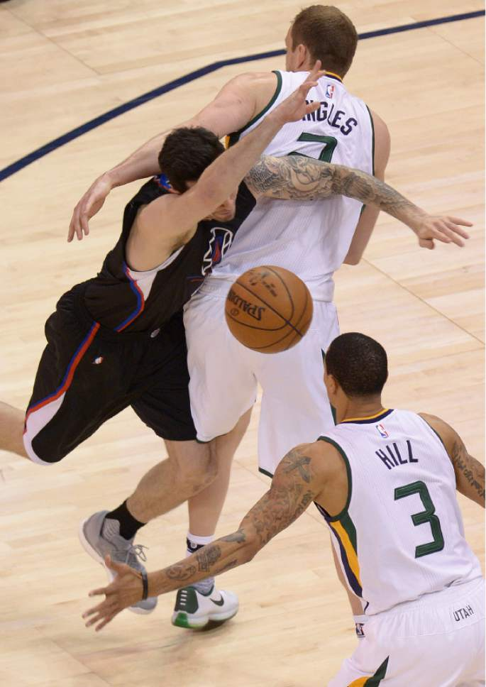 Leah Hogsten  |  The Salt Lake Tribune  Utah Jazz forward Joe Ingles (2) gets a personal foul and then a technical foul for the play with LA Clippers guard Austin Rivers (25). The Utah Jazz trail the Los Angeles Clippers 59-62 in the third quarter during Game 6 at Vivint Smart Home Arena, Friday, April 28, 2017 during the NBA's first-round playoff series.
