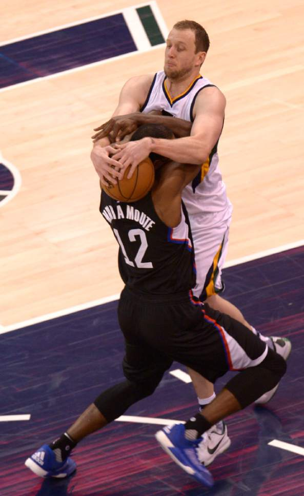 Leah Hogsten  |  The Salt Lake Tribune  Utah Jazz forward Joe Ingles (2) fouls LA Clippers forward Luc Mbah a Moute (12). The Utah Jazz trail the Los Angeles Clippers 59-62 in the third quarter during Game 6 at Vivint Smart Home Arena, Friday, April 28, 2017 during the NBA's first-round playoff series.