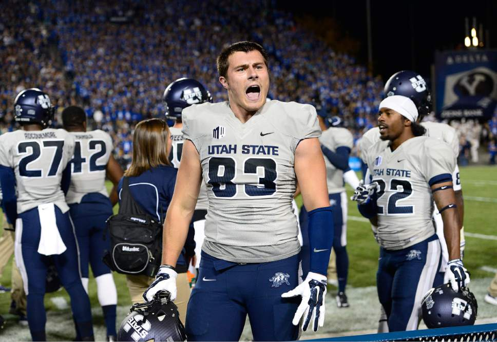Scott Sommerdorf     The Salt Lake Tribune Utah State Aggies tight end Wyatt Houston (83) yells to the BYU crowd after a USU TD made the score 21-14 late in the first half. Utah State led BYU 28-14 at the half in Provo, Friday, October 1, 2014.