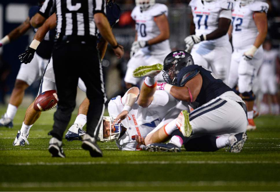 Scott Sommerdorf      The Salt Lake Tribune Boise State Broncos QB Brett Rypien (4) fumbles as he is sacked by Utah State Aggies DE Ricky Ali'ifua (95) during first quarter play. Utah State recovered and later scored a TD to go up 17-3. Utah State led Boise State 17-3 after one quarter of play, Friday, October 15, 2015.