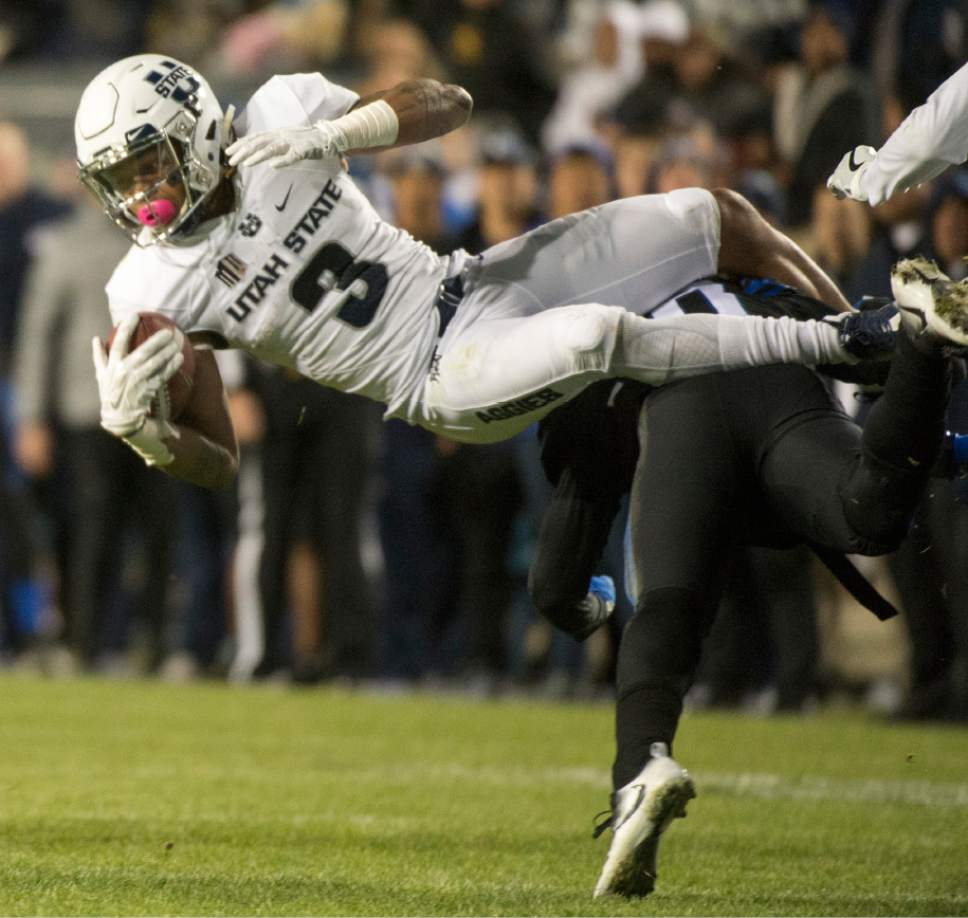 Rick Egan     The Salt Lake Tribune  Utah State Aggies safety Marquan Ellison (3 )gets tackled by Brigham Young Cougars defensive back Grant Jones (37), in football action, BYU vs Utah State, at Lavell Edwards Stadium in Provo,  Saturday, November 26, 2016.
