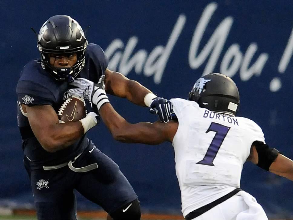 Utah State running back Devante Mays (32) runs past Weber State safety Josh Burton (7) during an NCAA college football game Thursday, Sept. 1, 2016, in Logan, Utah. (Eli Lucero/Herald Journal via AP)