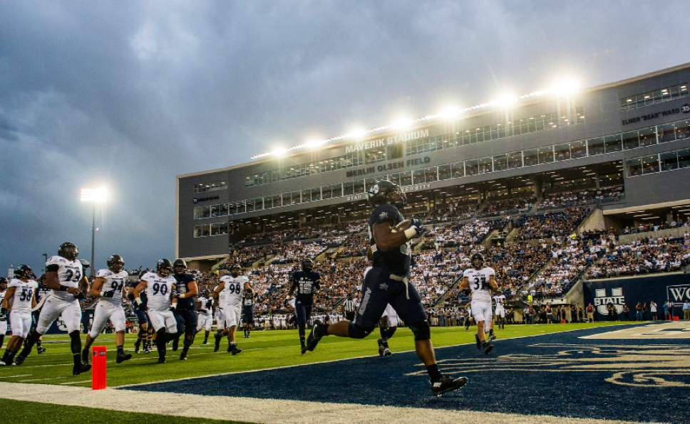 Chris Detrick  |  The Salt Lake Tribune Utah State Aggies running back Devante Mays (32) scores a touchdown during the game at Maverik Stadium Thursday September 1, 2016.