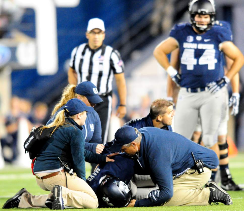 Utah State athletic trainers attend to running back Devante Mays during an NCAA college football game against Air Force, Saturday, Sept. 24, 2016, in Logan, Utah. (John Zsiray/Herald Journal via AP)