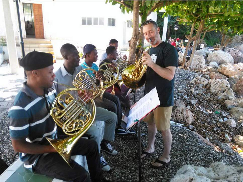 Utah Symphony horn player Steve Proser works with students in Jacmel, Haiti, during a weeklong teaching trip. Jules Youdley  |  Courtesy