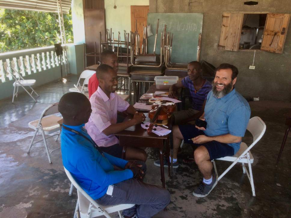 Salt Lake City luthier John Paul Lucas works with students in Jacmel, Haiti, during a weeklong teaching trip by Utah Symphony musicians. Jules Youdley  |  Courtesy