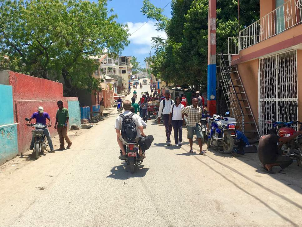 Utah Symphony cellist John Eckstein takes a motorcycle taxi back to his hotel after teaching students in Jacmel, Haiti. Yuki MacQueen  |  Courtesy