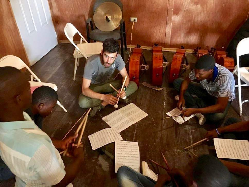 Utah Symphony percussionist Eric Hopkins works with students in Jacmel, Haiti, during a weeklong teaching trip. Jules Youdley  |  Courtesy