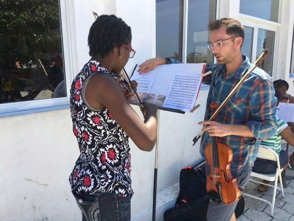 Utah Symphony violinist Claude Halter works with students in Jacmel, Haiti, during a weeklong teaching trip. Jules Youdley  |  Courtesy