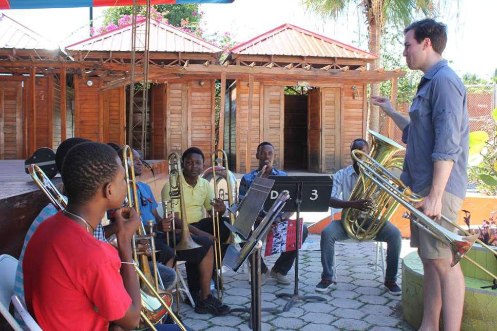 Detroit Symphony trombonist David Binder works with students in Jacmel, Haiti, during a weeklong teaching trip. (Binder accompanied the Utah Symphony musicians on the Haiti trip because the Utah Symphony was conducting trombone auditions that week, so its trombone players couldn't go.) Jules Youdley  |  Courtesy
