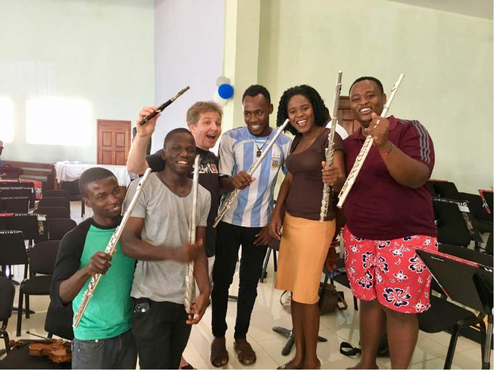Utah Symphony music director Thierry Fischer, who was a professional flutist before switching to conducting, poses with the flutists of the student orchestra during a weeklong teaching trip to Jacmel, Haiti. Yuki MacQueen  |  Courtesy