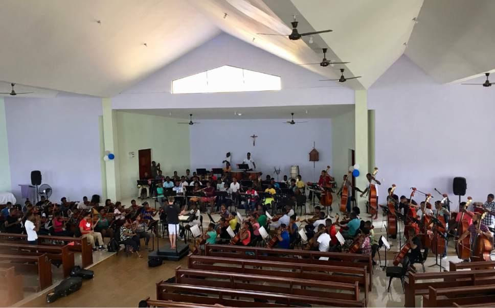 Thierry Fischer conducts the dress rehearsal during a weeklong teaching trip to Jacmel, Haiti. Yuki MacQueen  |  Courtesy
