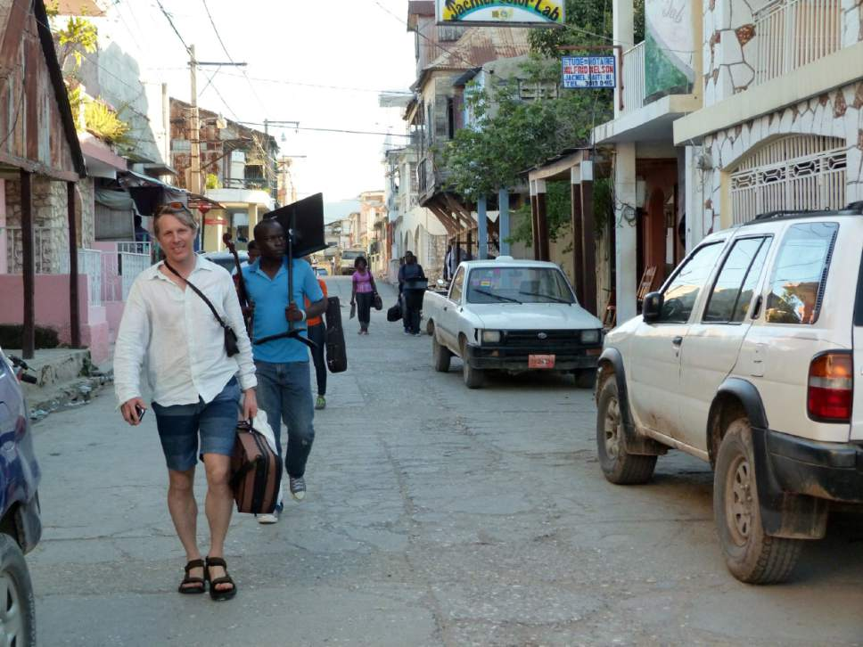 Utah Symphony violinist David Porter leads his students to the wharf in Jacmel, Haiti, where he and David Langr coached them during the orchestra's weeklong teaching trip. David Langr  |  Courtesy