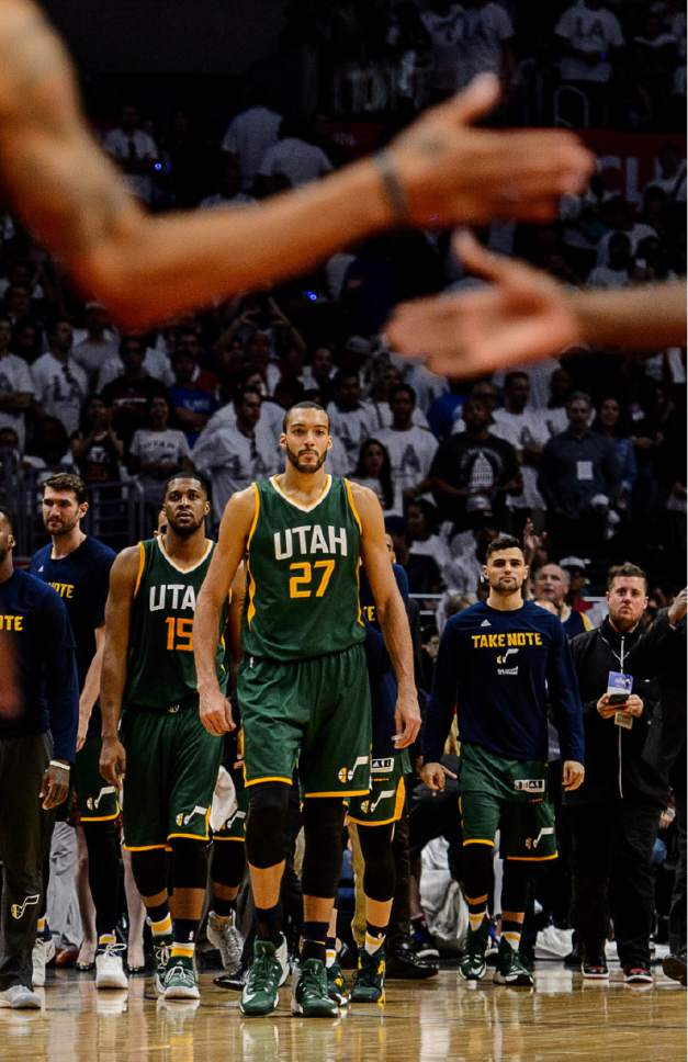 Trent Nelson  |  The Salt Lake Tribune Utah Jazz forward Derrick Favors (15) and Utah Jazz center Rudy Gobert (27) walk onto the court to celebrate the win as the Utah Jazz face the Los Angeles Clippers in Game 7 at STAPLES Center in Los Angeles, California, Sunday April 30, 2017.