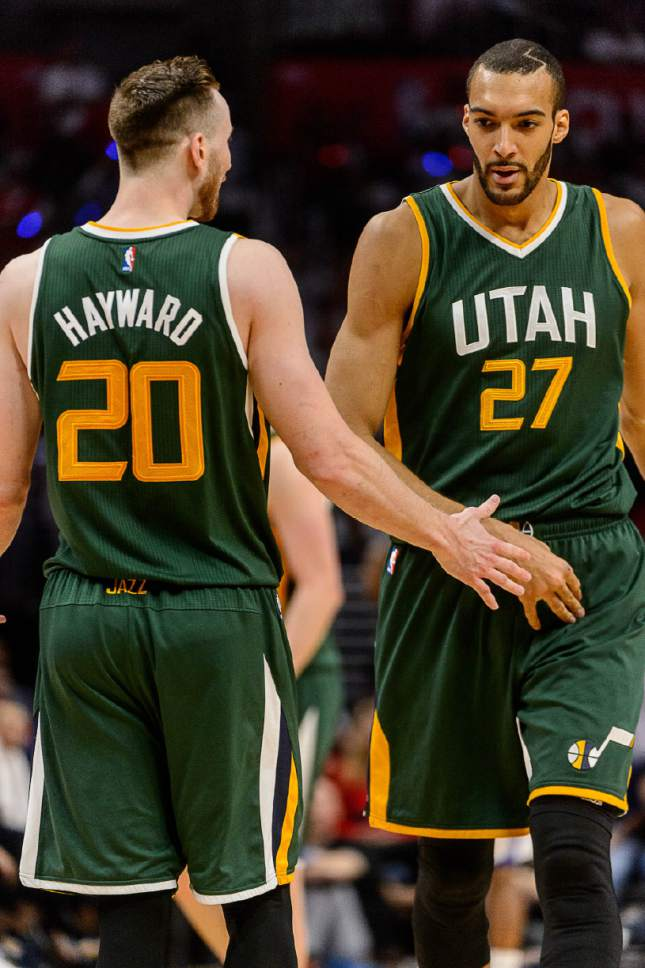 Trent Nelson  |  The Salt Lake Tribune Utah Jazz forward Gordon Hayward (20) and Utah Jazz center Rudy Gobert (27) high-five as the Utah Jazz face the Los Angeles Clippers in Game 7 at STAPLES Center in Los Angeles, California, Sunday April 30, 2017.