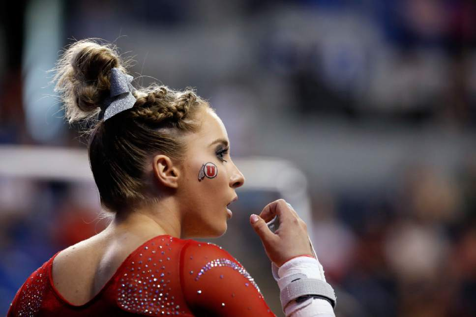 Utah's MyKayla Skinner prepares before competing on the uneven parallel bars during the NCAA women's gymnastics championships Friday, April 14, 2017, in St. Louis. (AP Photo/Jeff Roberson)