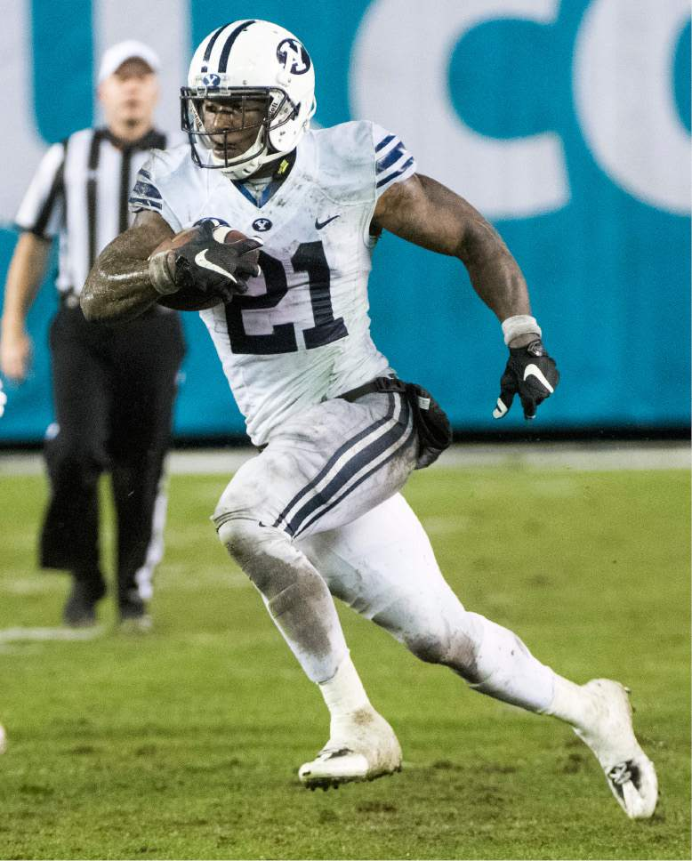 Rick Egan  |  The Salt Lake Tribune  Brigham Young running back Jamaal Williams (21) to run for a 36-yard touchdown for the Cougars, in the Poinsettia Bowl, at Qualcomm Stadium in San Diego, December 21, 2016.