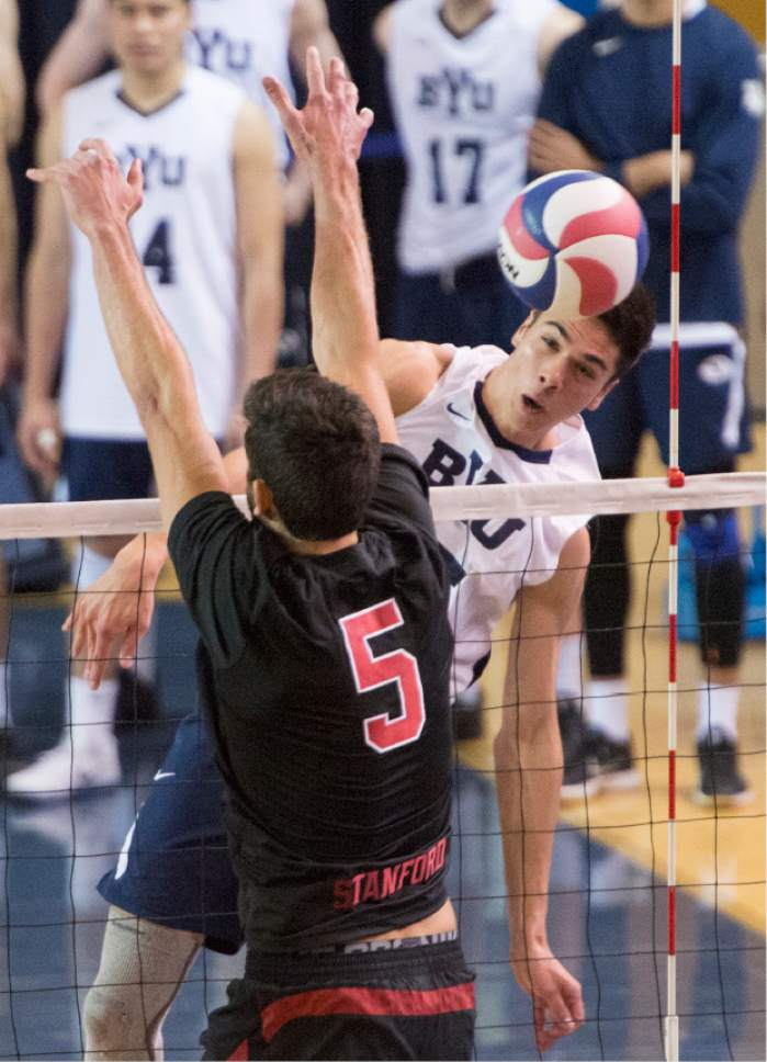 Rick Egan  |  The Salt Lake Tribune  Brenden Sander (15) BYU, hits the ball past Gabriel Vega (5) Stanford, in Volleyball action, BYU vs. Stanford, at the Smith Field House in Provo,  Saturday, April 15, 2017.