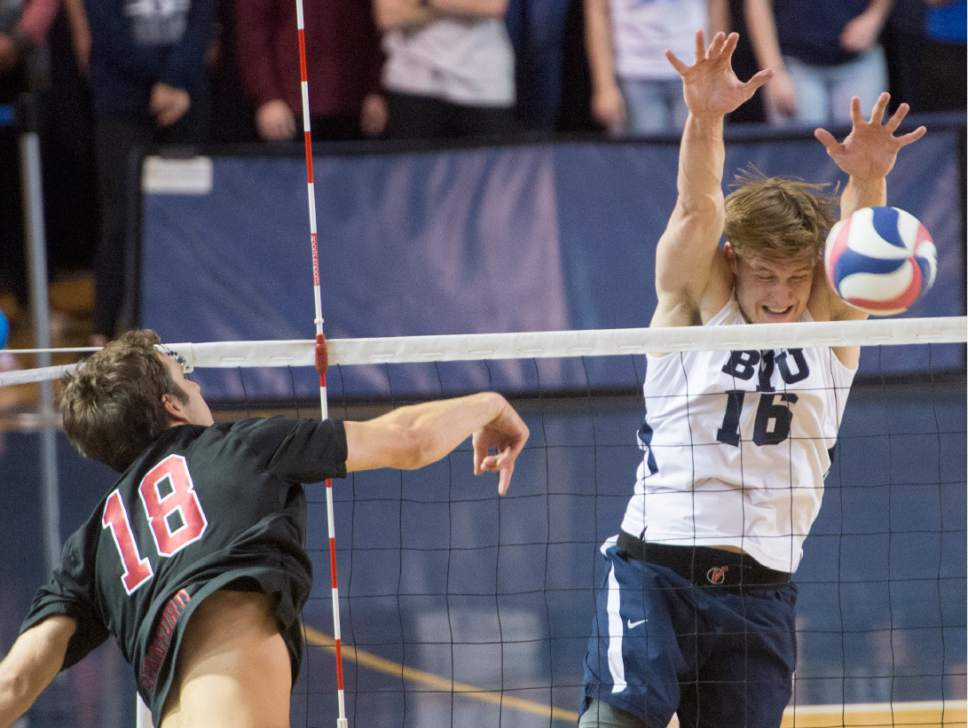 Rick Egan  |  The Salt Lake Tribune  Clay Jones (18) Stanford, hits the ball, as Tim Dobbert (16) BYU defends, in Volleyball action, BYU vs. Stanford, at the Smith Field House in Provo,  Saturday, April 15, 2017.