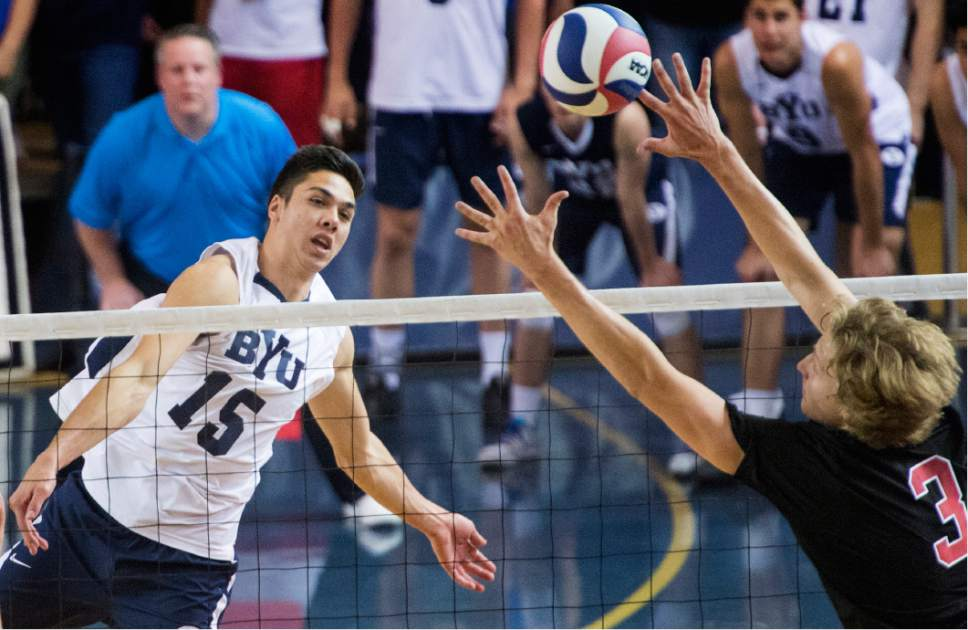 Rick Egan  |  The Salt Lake Tribune  Brenden Sander (5) BYU, hits the ball past Paul Bischoff (3) Stanford, in Volleyball action, BYU vs. Stanford, at the Smith Field House in Provo,  Saturday, April 15, 2017.