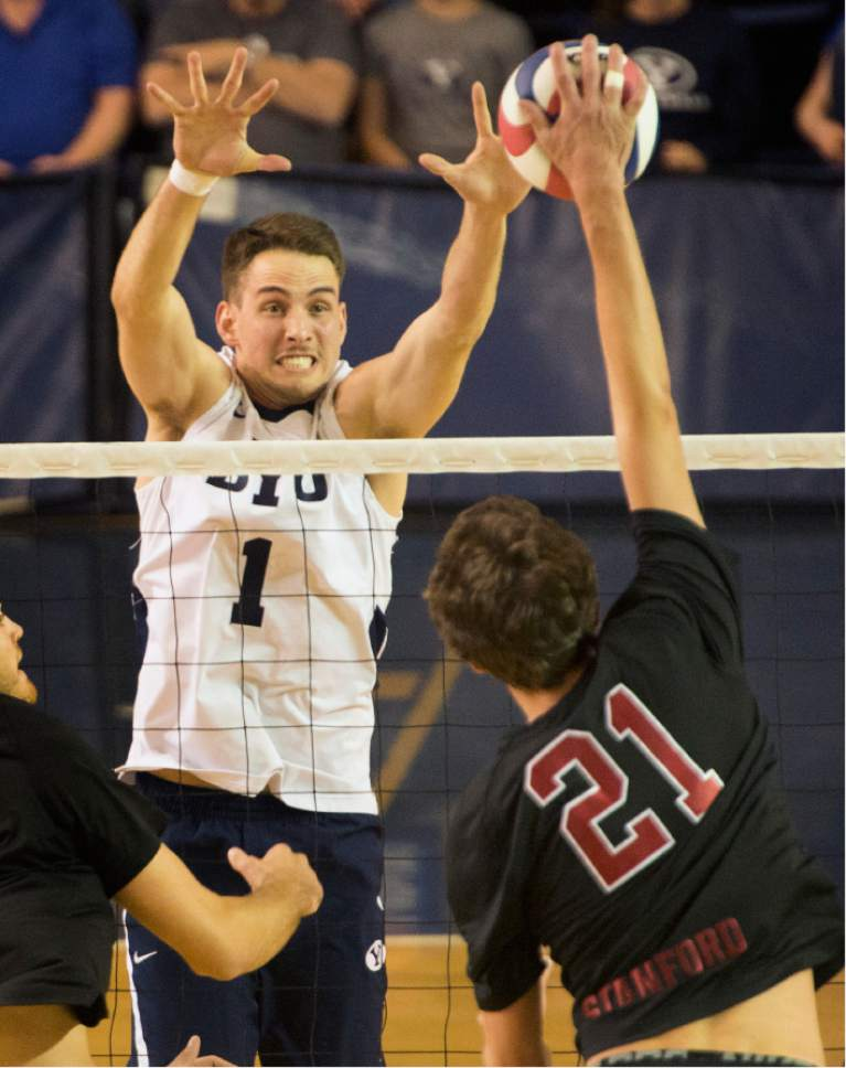 Rick Egan  |  The Salt Lake Tribune  COLIN MCCALL Colin McCall (21) Stanford, tries to get the ball past Price Jarman (1) BYU, in Volleyball action, BYU vs. Stanford, at the Smith Field House in Provo,  Saturday, April 15, 2017.
