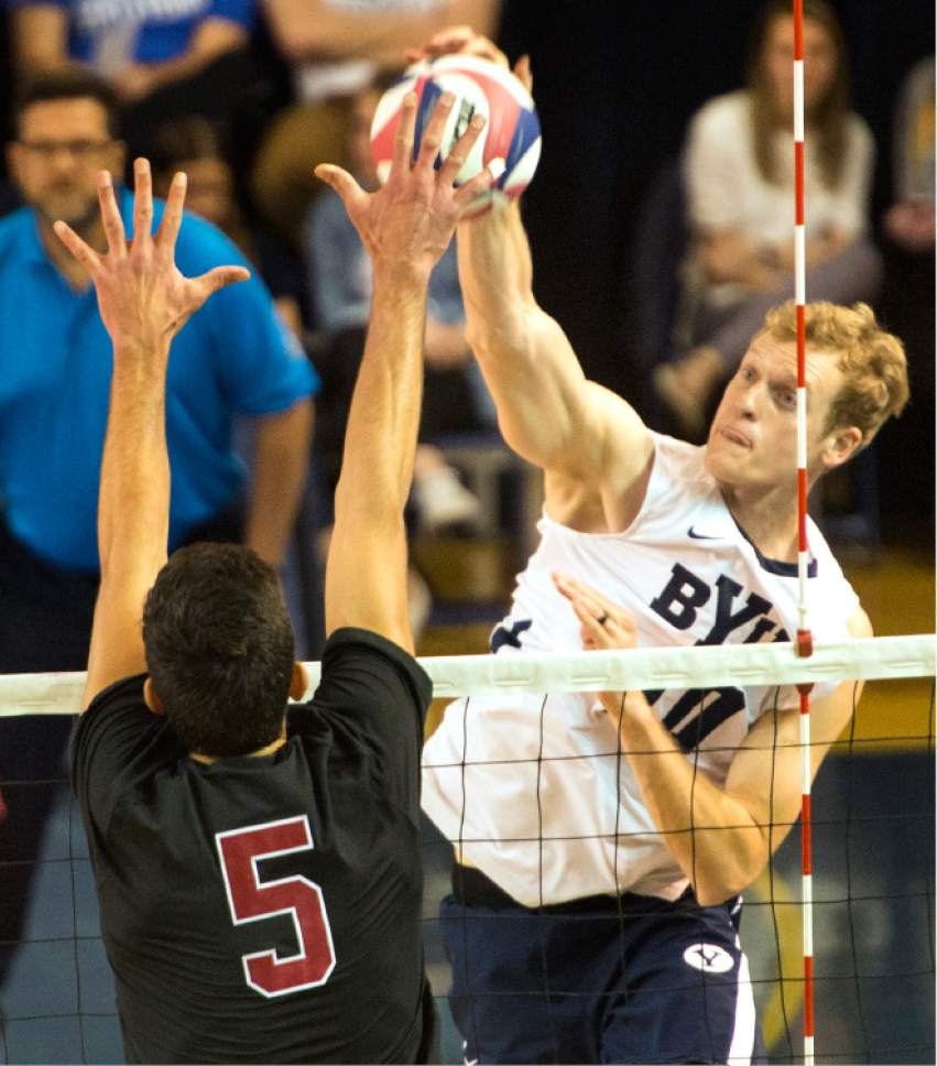 Rick Egan  |  The Salt Lake Tribune  Jake Langlois (10) BYU, tries to get the ball past Gabriel Vega (5) Stanford, in Volleyball action, BYU vs. Stanford, at the Smith Field House in Provo,  Saturday, April 15, 2017.
