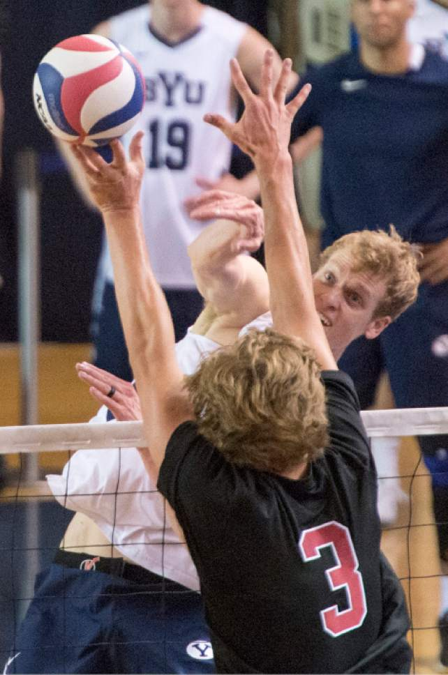 Rick Egan  |  The Salt Lake Tribune  Jake Langlois (10) BYU, tries to get the ball pastPaul Bischoff (3) Stanford, in Volleyball action, BYU vs. Stanford, at the Smith Field House in Provo,  Saturday, April 15, 2017.
