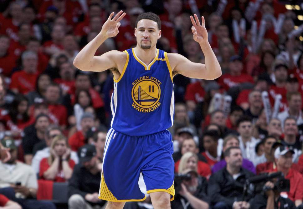 04d19e1a810 Golden State Warriors guard Klay Thompson reacts after making a three-point basket  against the. Golden State Warriors guard Stephen Curry ...