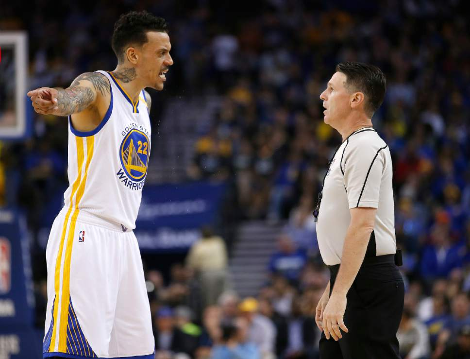 Golden State Warriors forward Matt Barnes (22) argues a call with referee Mike Callahan during the first half of the team's NBA basketball game against the Minnesota Timberwolves on Tuesday, April 4, 2017, in Oakland, Calif. (AP Photo/Tony Avelar)