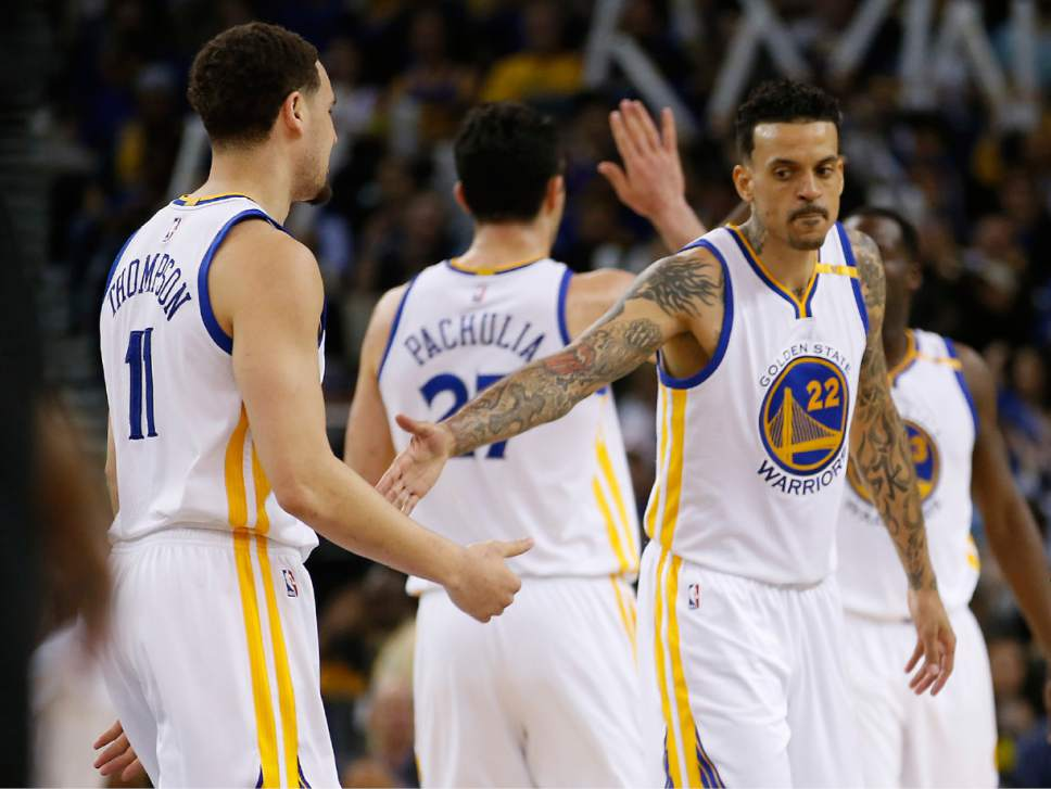 Golden State Warriors forward Matt Barnes (22) congratulates guard Klay Thompson (11) after he made a 3-point shot against the Minnesota Timberwolves during the second half of an NBA basketball game Tuesday, April 4, 2017, in Oakland, Calif. (AP Photo/Tony Avelar)