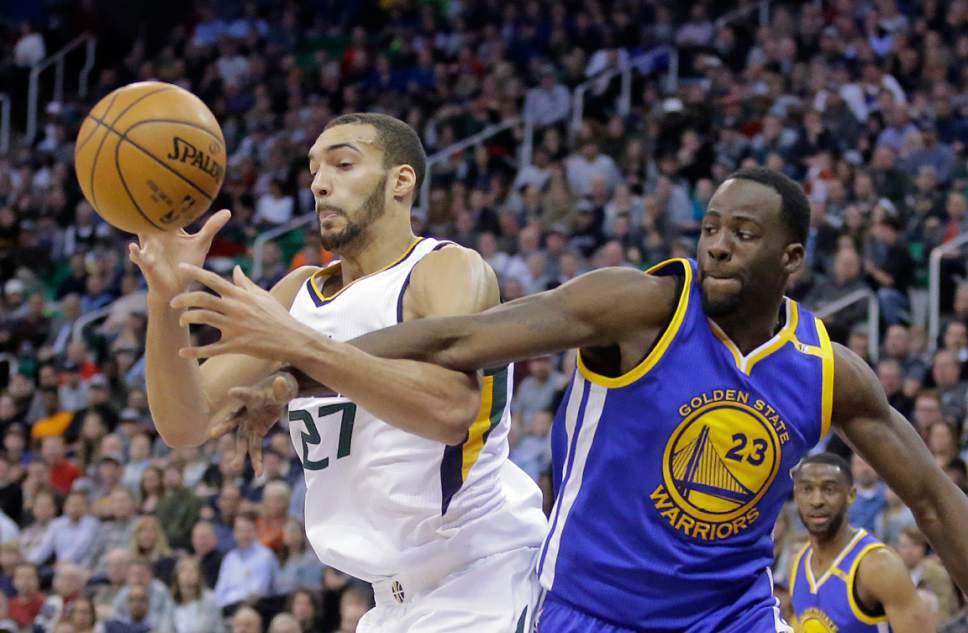 FILE - In this Dec. 8, 2016, file photo, Utah Jazz center Rudy Gobert (27) and Golden State Warriors forward Draymond Green (23) battle for a rebound in the second half during an NBA basketball game in Salt Lake City. Golden State and Utah being their best-of-seven NBA second round playoff series on Tuesday, May 2. (AP Photo/Rick Bowmer, File)