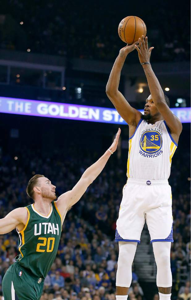 FILE - In this Dec. 20, 2016, file photo, Golden State Warriors forward Kevin Durant (35) takes a 3-point shot over Utah Jazz forward Gordon Hayward (20) during the first half of an NBA basketball game in Oakland, Calif. Golden State and Utah begin their best-of-seven NBA second round playoff series on Tuesday, May 2.(AP Photo/Tony Avelar, File)