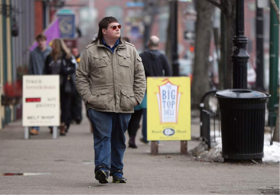 ADVANCE FOR USE MONDAY, MAY 1, 2017 AND THEREAFTER-In this Feb. 24, 2017 photo, Chaz Wing walks down Maine Street in Brunswick, Maine. Wing has testified that he was raped by other kids three times in his first year in junior high, even after repeatedly complaining of harassment to teachers and administrators. Chaz's saga is more than a tale of escalating bullying. Across the U.S., thousands of students have been sexually assaulted, by other students, in high schools, junior highs and even elementary schools _ a hidden horror educators have long been warned not to ignore. (AP Photo/Robert F. Bukaty)