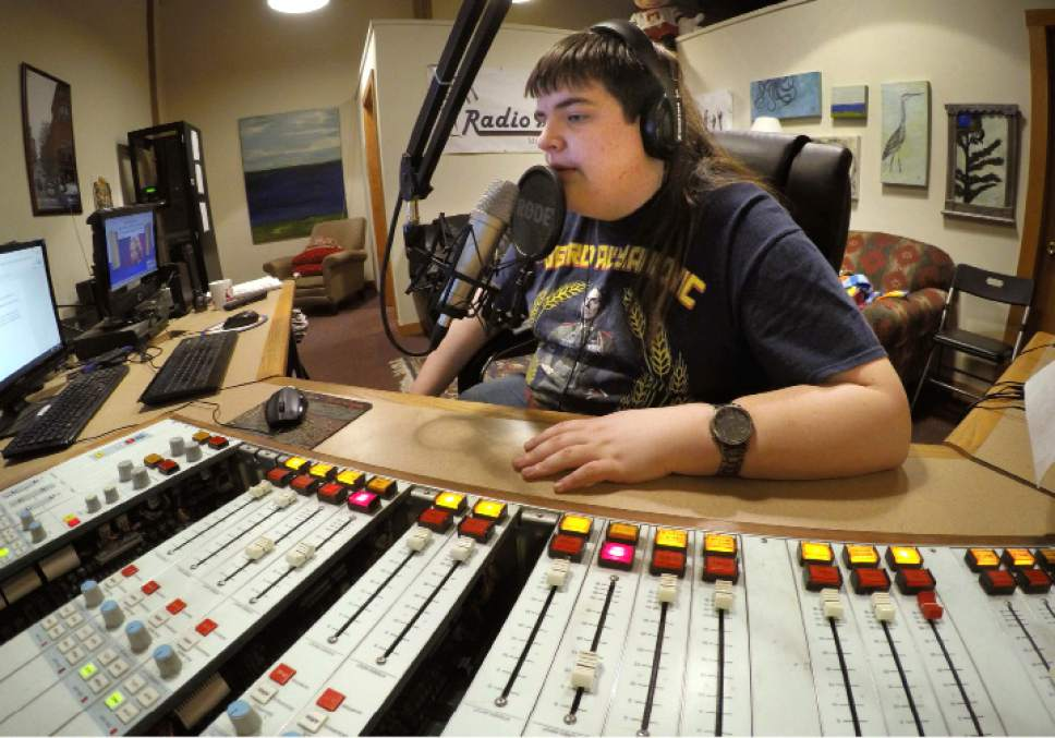 ADVANCE FOR USE MONDAY, MAY 1, 2017 AND THEREAFTER-In this March 18, 2017 photo, Chaz Wing records the weather forecast at a radio station in Brunswick, Maine. Wing has testified that he was raped by other kids three times in his first year in junior high, even after repeatedly complaining of harassment to teachers and administrators. Chaz's saga is more than a tale of escalating bullying. Across the U.S., thousands of students have been sexually assaulted, by other students, in high schools, junior highs and even elementary schools _ a hidden horror educators have long been warned not to ignore. (AP Photo/Robert F. Bukaty)