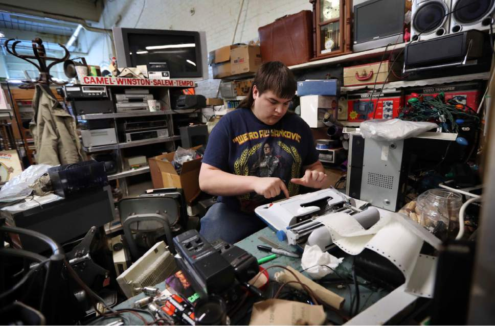 """ADVANCE FOR USE MONDAY, MAY 1, 2017 AND THEREAFTER-In this March 18, 2017 photo, Chaz Wing types labels for electronic equipment he fixes and sells at a flea market in Brunswick, Maine. From almost his first day at Brunswick Junior High, Chaz said kids harassed him. Complaining to teachers and administrators didn't help, he said. Then one day in 2012, his mom came home and found him curled up in her bed, rocking back and forth. She begged him to tell her what was wrong. Slowly, his words came out. """"They hurt me,"""" he cried. (AP Photo/Robert F. Bukaty)"""