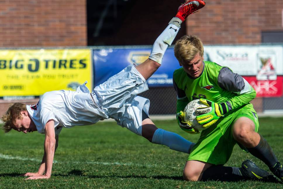 Chris Detrick  |  The Salt Lake Tribune Skyridge's Andrew Witt (52) makes a save against Alta's Seth Lowry (10) during the game at Alta High School Tuesday, May 2, 2017.
