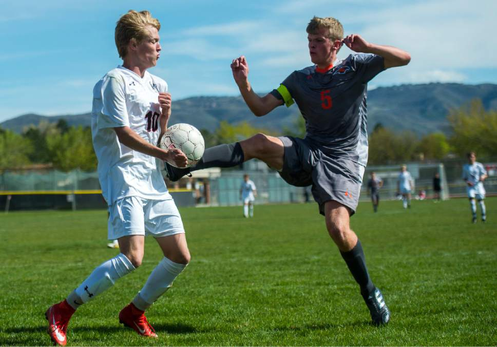 Chris Detrick  |  The Salt Lake Tribune Alta's Seth Lowry (10) and Skyridge's Benjamin Driggs (5) go for the ball during the game at Alta High School Tuesday, May 2, 2017.
