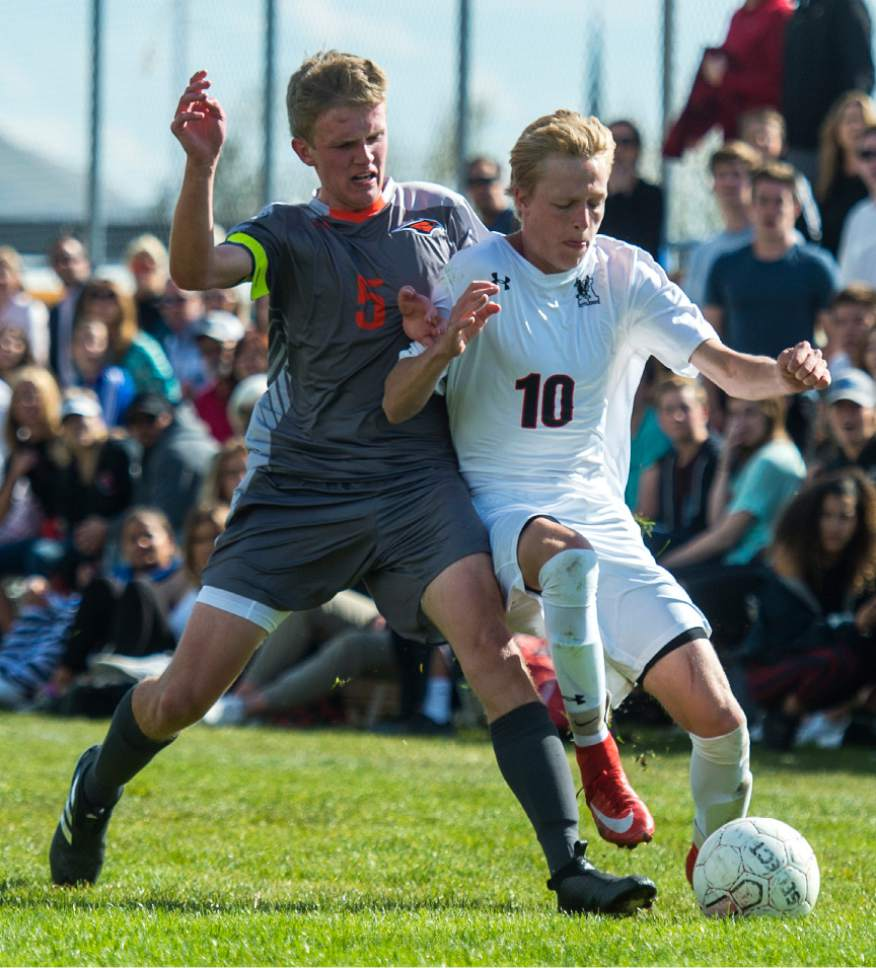 Chris Detrick  |  The Salt Lake Tribune Skyridge's Benjamin Driggs (5) and Alta's Seth Lowry (10) go for the ball during the game at Alta High School Tuesday, May 2, 2017.