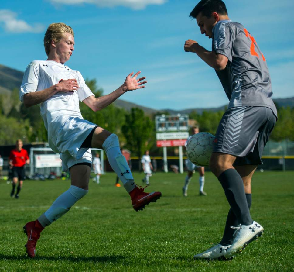 Chris Detrick  |  The Salt Lake Tribune Alta's Seth Lowry (10) and Skyridge's Tyler Rollins (21) go for the ball during the game at Alta High School Tuesday, May 2, 2017.
