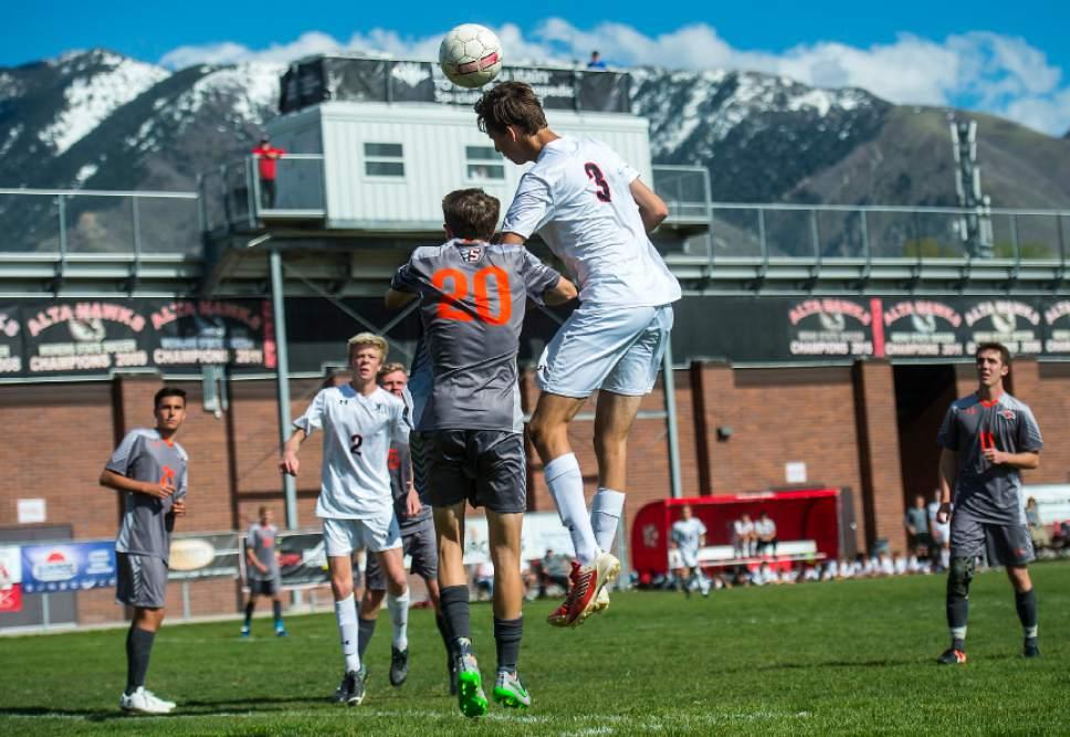 Chris Detrick  |  The Salt Lake Tribune Alta's Noah Plowman (3) heads the ball over Skyridge's McCoy Evers (20) during the game at Alta High School Tuesday, May 2, 2017.