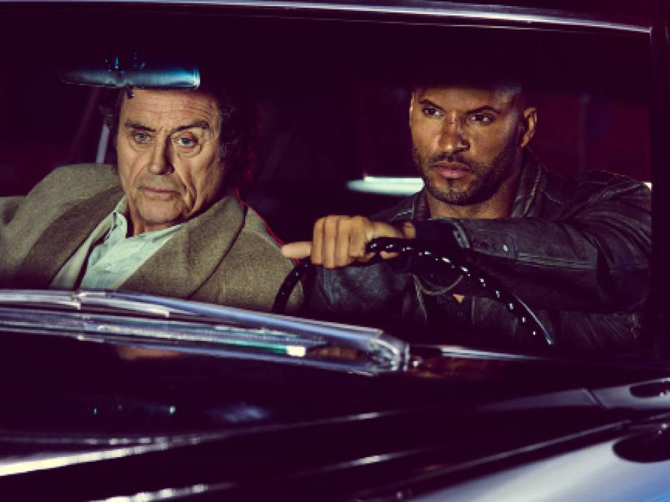 "Ian McShane as Mr. Wednesday and Ricky Whittle as Shadow Moon in ""American Gods."" Courtesy Starz"