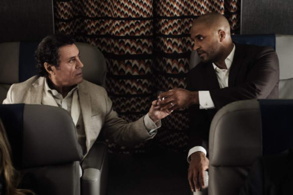 "Ricky Whittle as Shadow Moon and Ian McShane as Mr. Wednesday in ""American Gods."" Courtesy Starz"