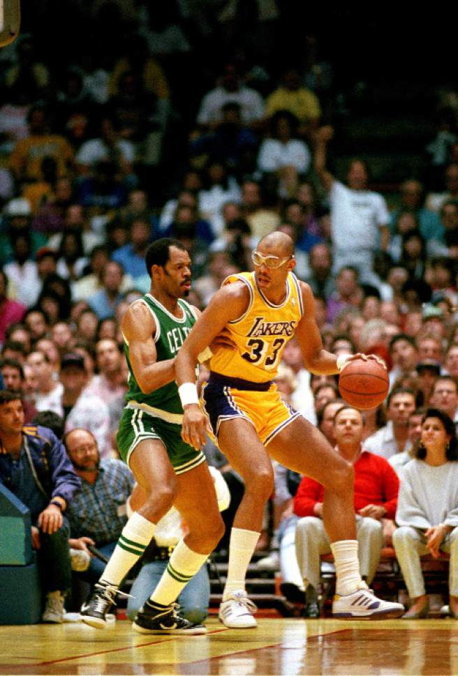 Artis Gilmore, left, of the Boston Celtics, tries to block Kareem Abdul-Jabbar of the Los Angeles Lakers during NBA game at the Forum in Inglewood, Ca., Feb. 14, 1988.  The Lakers won 115-106.  (AP Photo/Ira Mark Gostin)